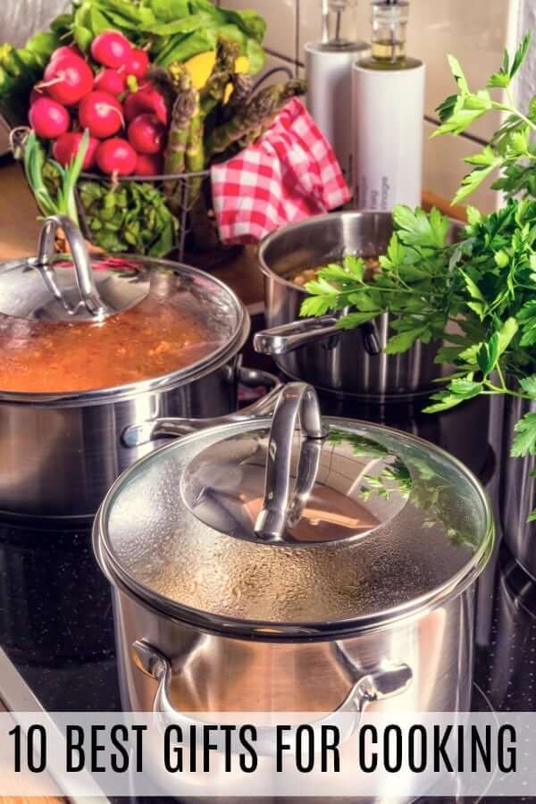 Gifts for Cooking Soup - Stainless steal soup pots surrounded by greens