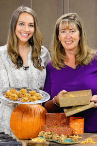 About me at KSEE24 - Christina and Deb holding a platter of cookies .