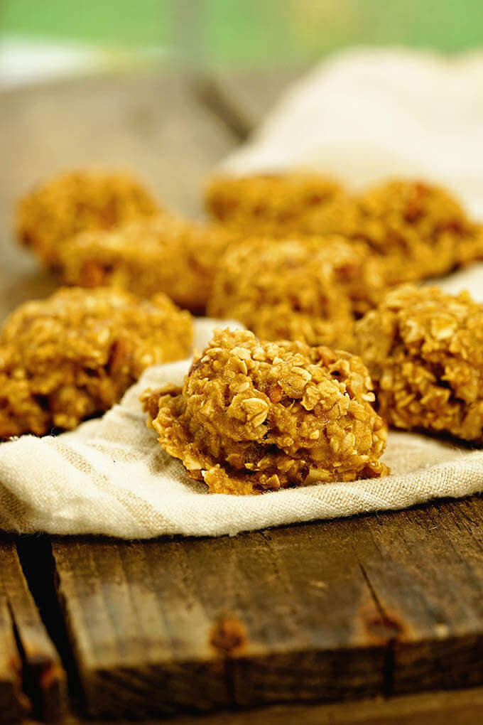 3 ingredient oatmeal cookie recipe. Cookies are on a wooden board and white towel.