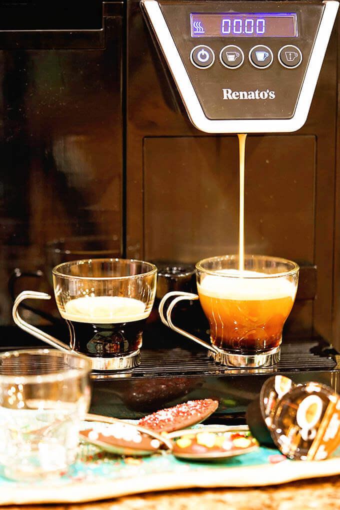 Renato's espresso maker with two cups of espresso.