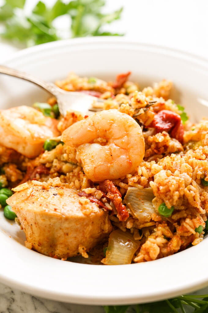 A white bowl filled with Paella