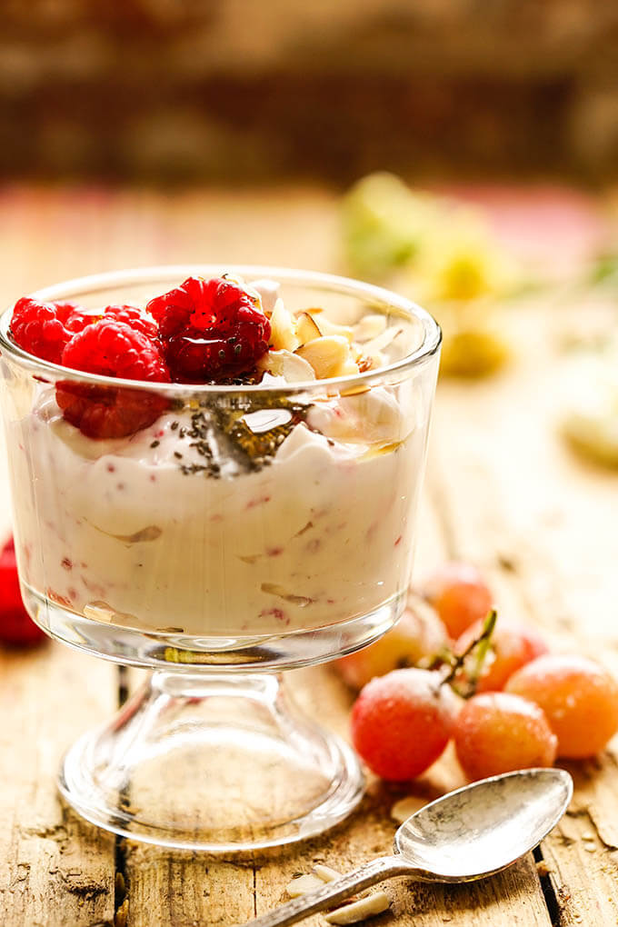 Make ahead breakfast Yogurt parfait topped with raspberries and sliced almonds