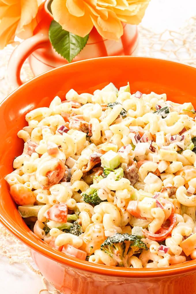 Pasta Salad in orange bowl.