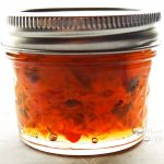Jar of Hot Pepper Jam on silver counter.
