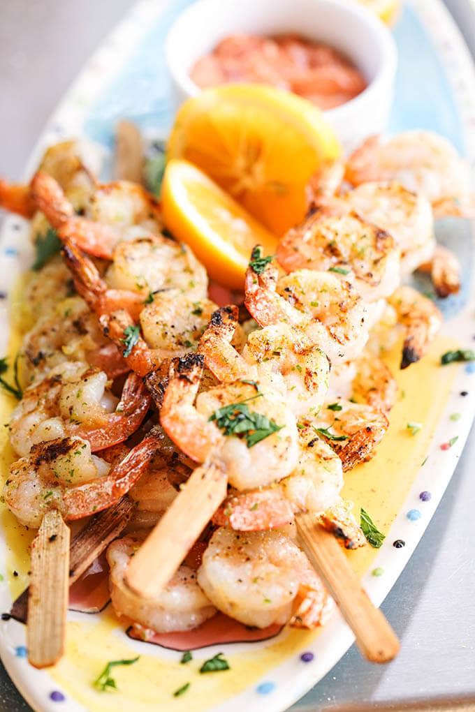 Platter of grilled shrimp skewers.