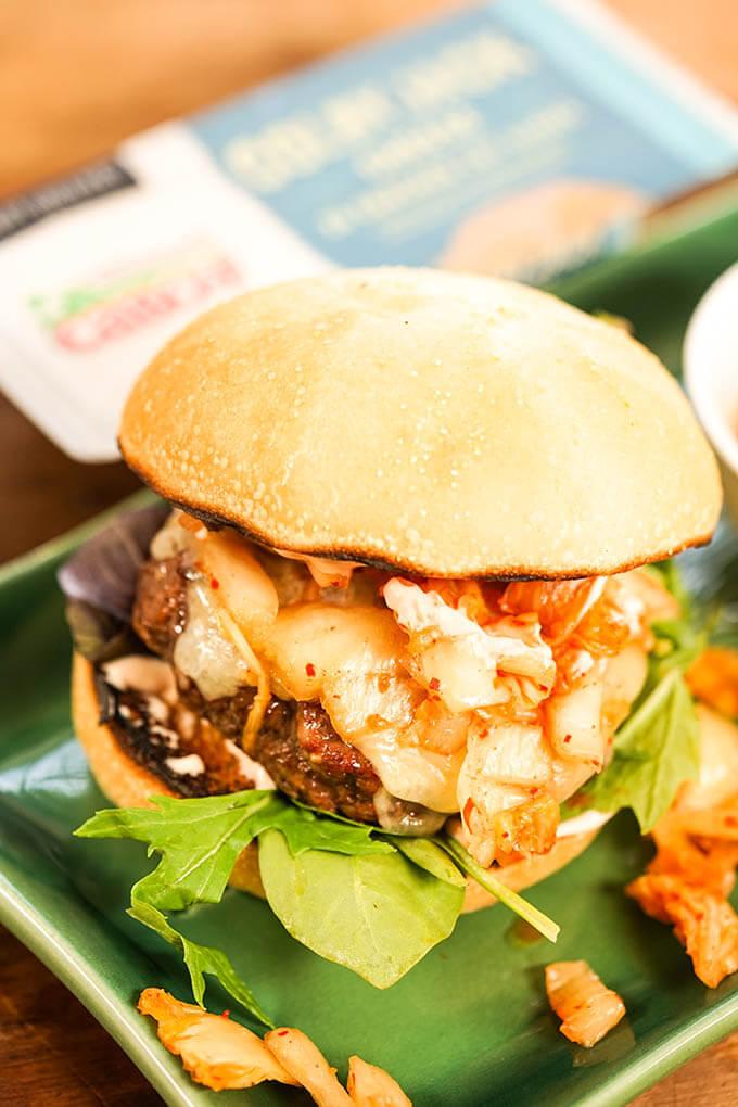 Korean Style Burger on green plater.