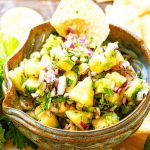 Pineapple Salsa in blue bowl with chips