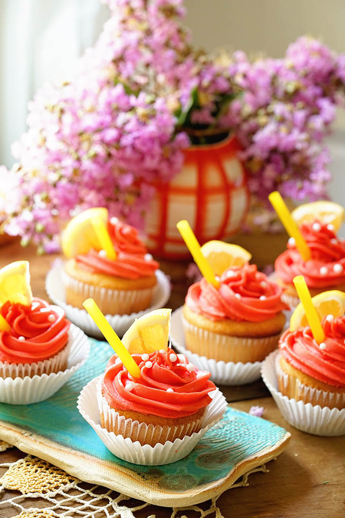 Lemonade Cupcakes on platter with flowers.