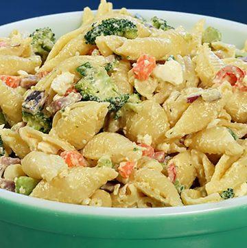Ham pasta salad in green bowl