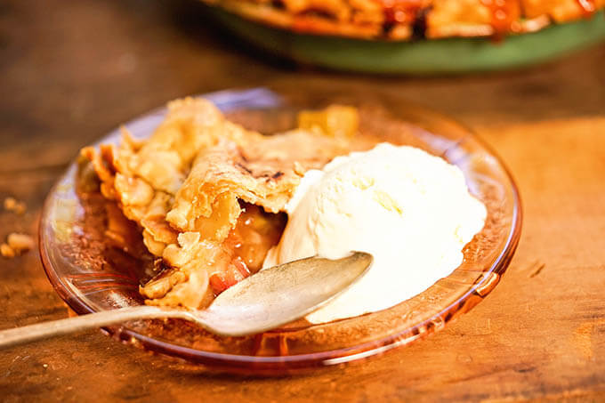Rhubarb Pie on plate with vanilla ice cream.