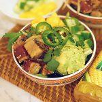 Poke bowl with seared tuna, avocado and mango chunks.