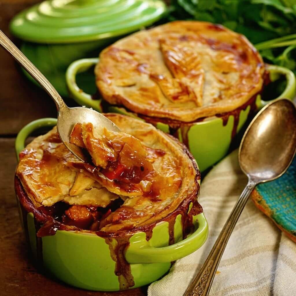 Turkey Pot Pie in green ramekin with spoon.