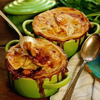 Turkey Pot Pie in green ramekin with spoon.