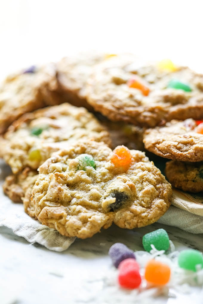 A pile cookies on white plate.