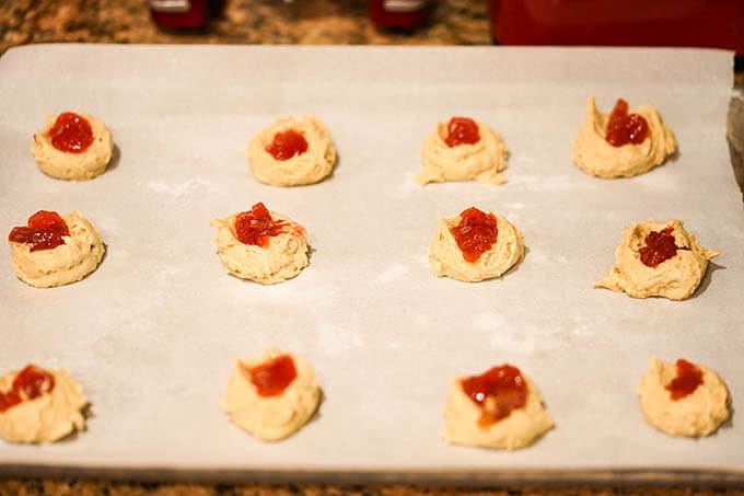 Cookies on cookie sheet filled with jam