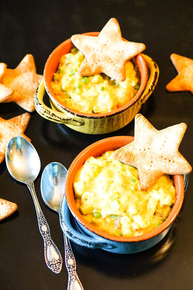 Two bowls filled with Easy Chicken Pot Pie Soup, topped with crackers