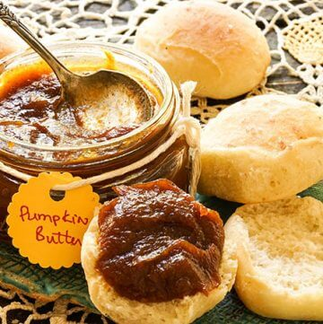 Pumpkin butter and rolls on blue platter