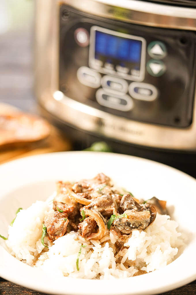 Crockpot Beef Stroganoff in bowl over rice.