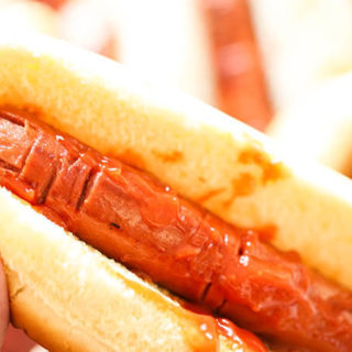 Hot dogs carved to look like fingers in bun with ketchup for Halloween Party Food