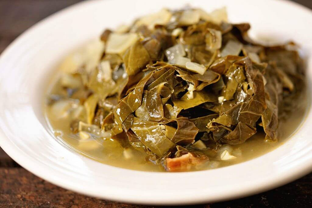 White bowl filled with Collards/