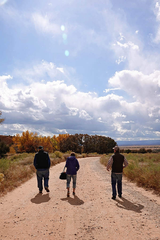 BEST things to do in Santa Fe New Mexic strolling along a dirt road and enjoy the view