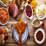 Ham and Thanksgiving Side Dishes on wood table