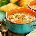Chicken and wild rice soup recipe in blue bowl