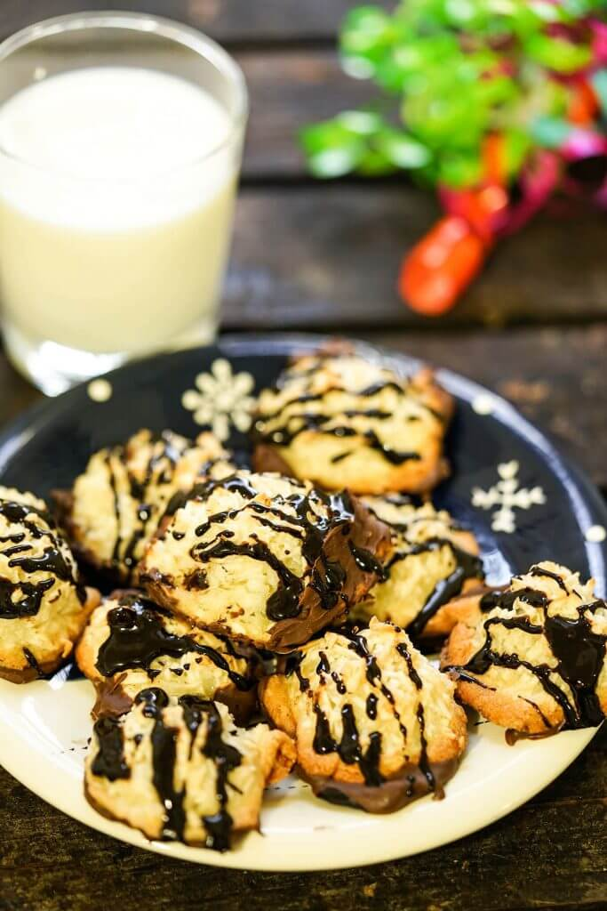 Chocolate Dipped Coconut Macaroons on plate with milk.