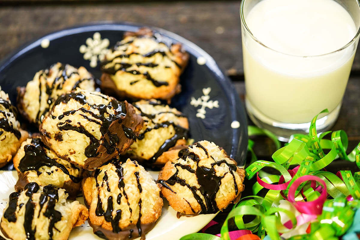 Chocolate Dipped Macaroons on plate with milk for Santa!