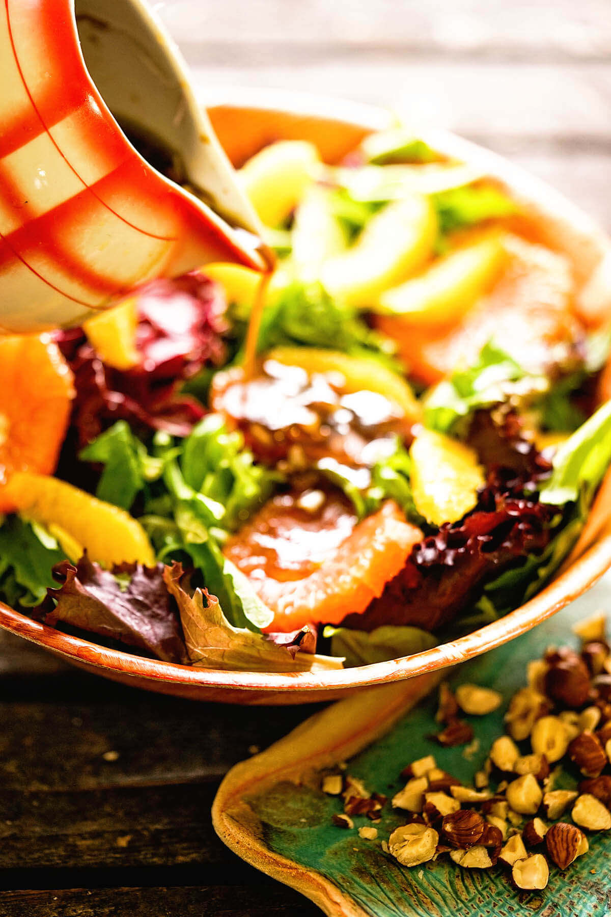 Citrus Salad Recipe topped with orange slices, nuts and homemade salad dressing.