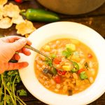 Bowl filled with White Bean Turkey Chili Recipe with spoon.