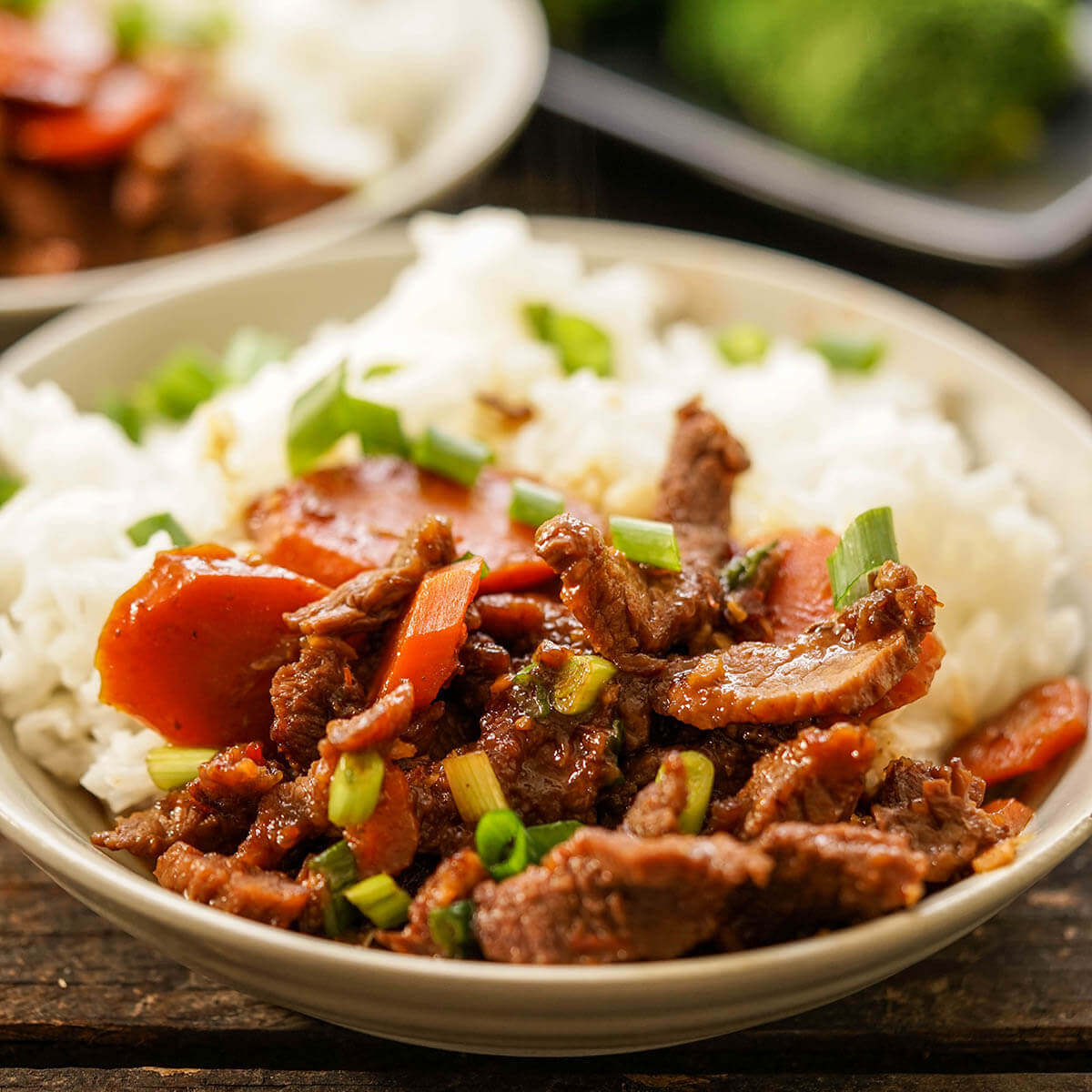 Stir-fried beef with vegetables in bowl with rice.