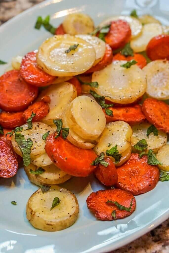 Oven Baked Carrots on white platter.