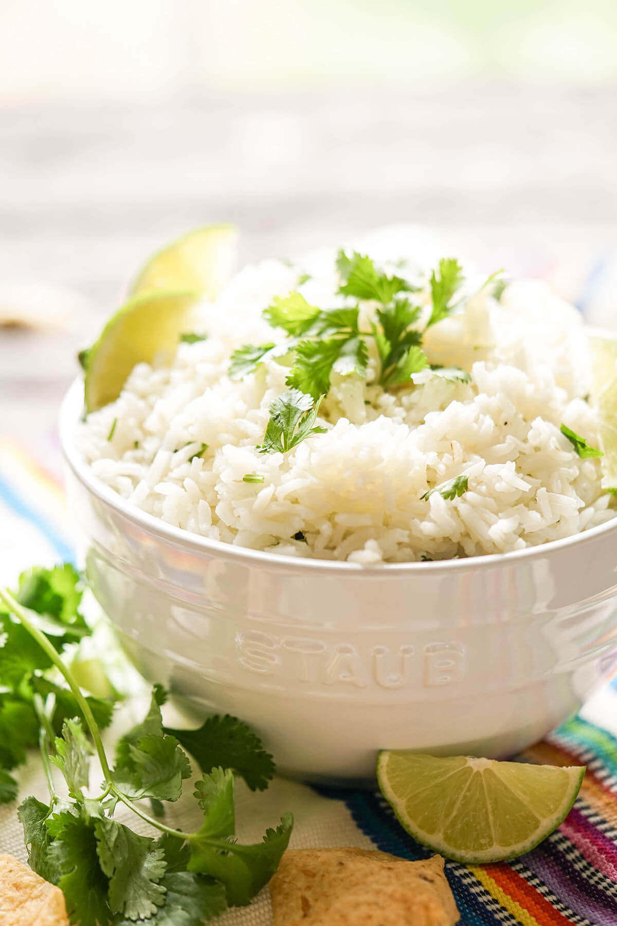 Cilantro Lime Rice in white bowl with chips.