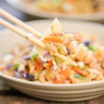 Egg Roll in a bowl with chopsticks.