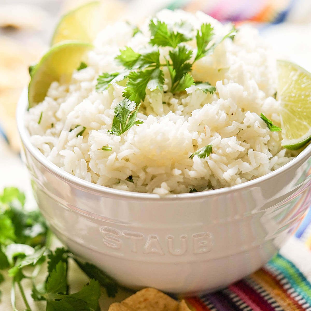 White rice in bowl topped with cilantro.