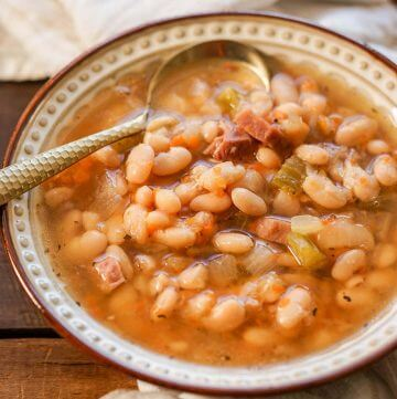 Navy Bean Soup in White Bowl with spoon.