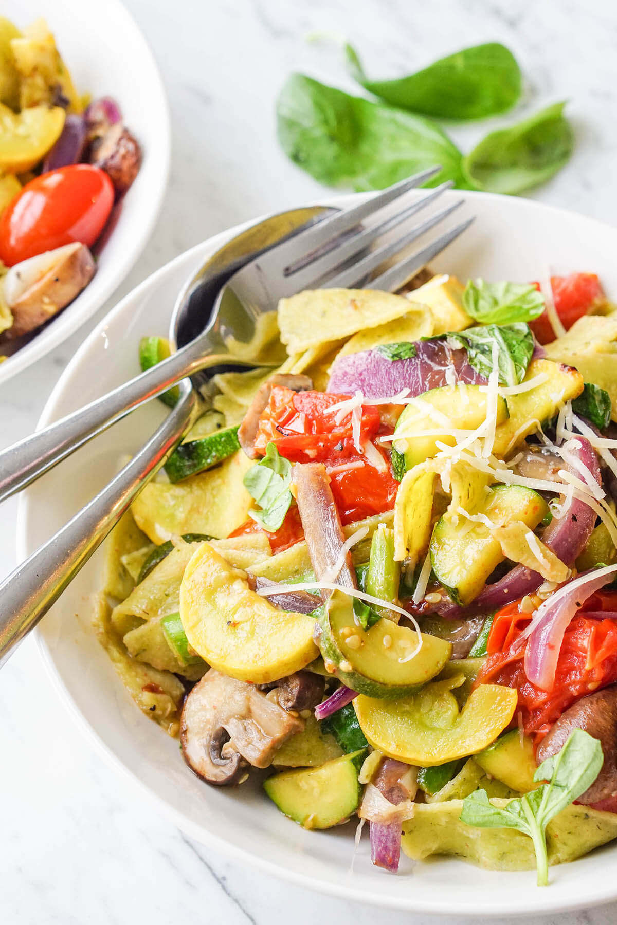 Vegetable Pasta Primavera in white bowl with fork.