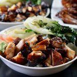 Grilled Teriyaki Chicken in a white bowl with vegetables