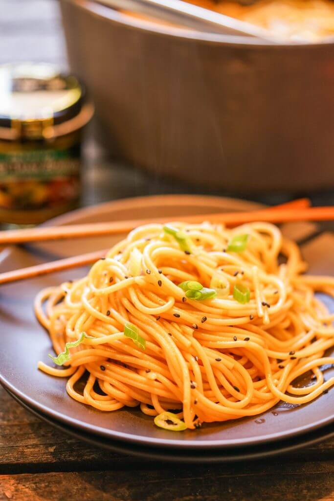 Spicy Sesame Noodles on plate with chopsticks.