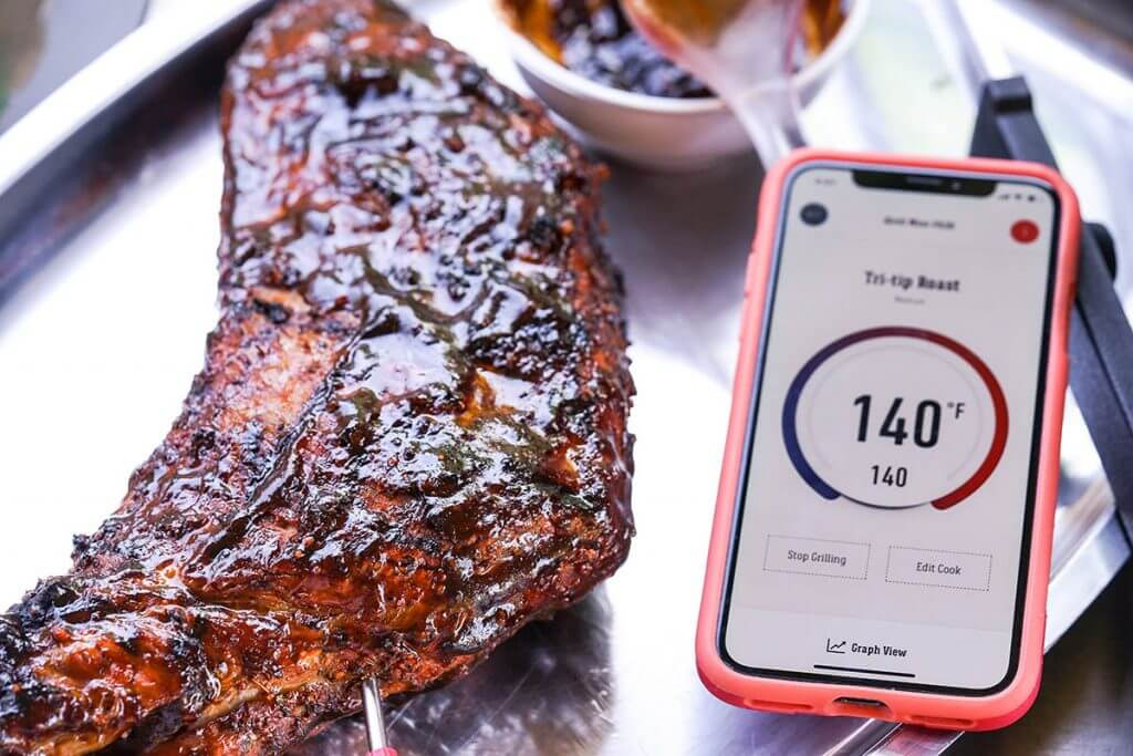 Steak on platter with thermometer.