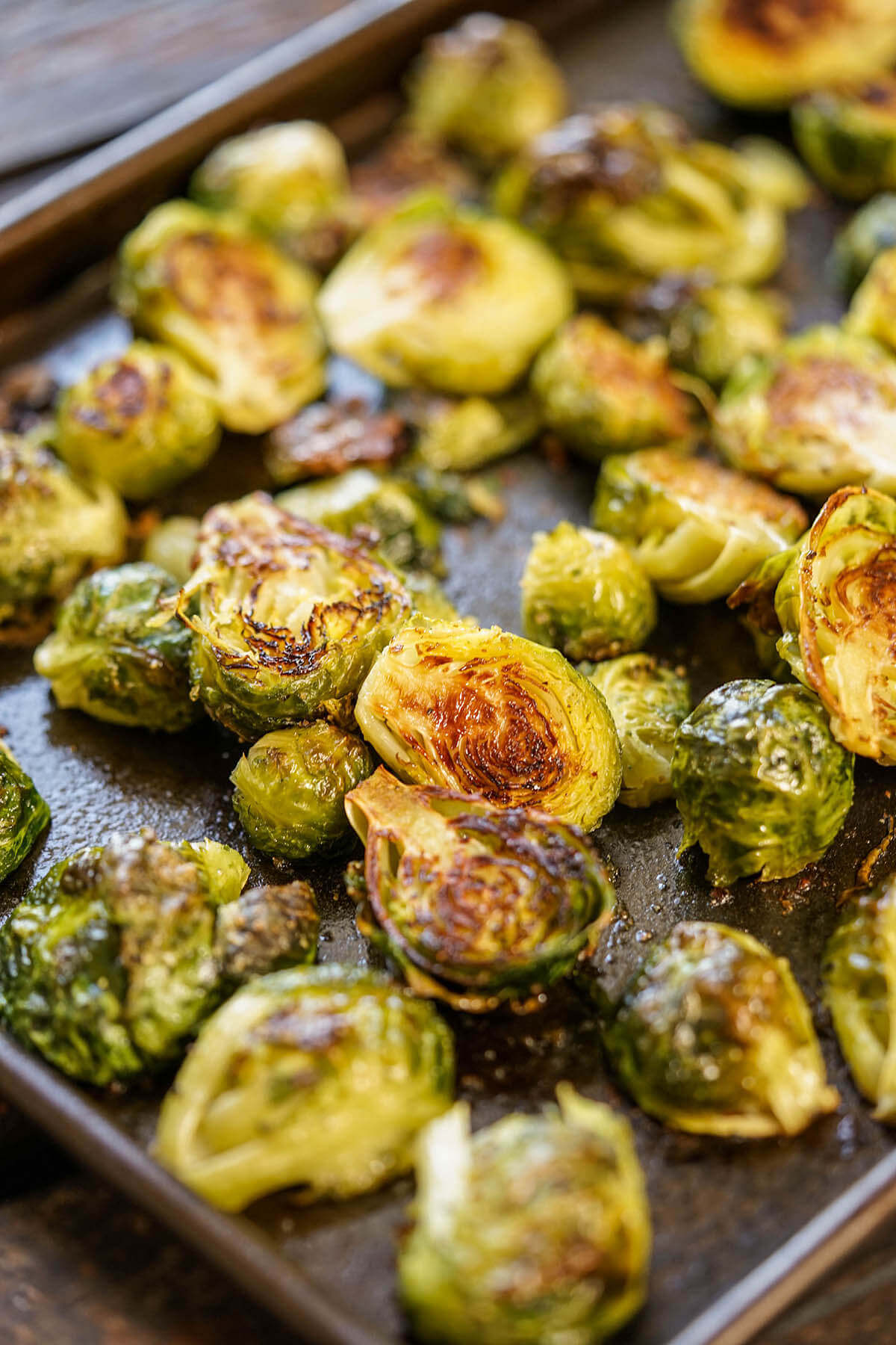 Oven Roasted Brussels sprouts on sheet pan.