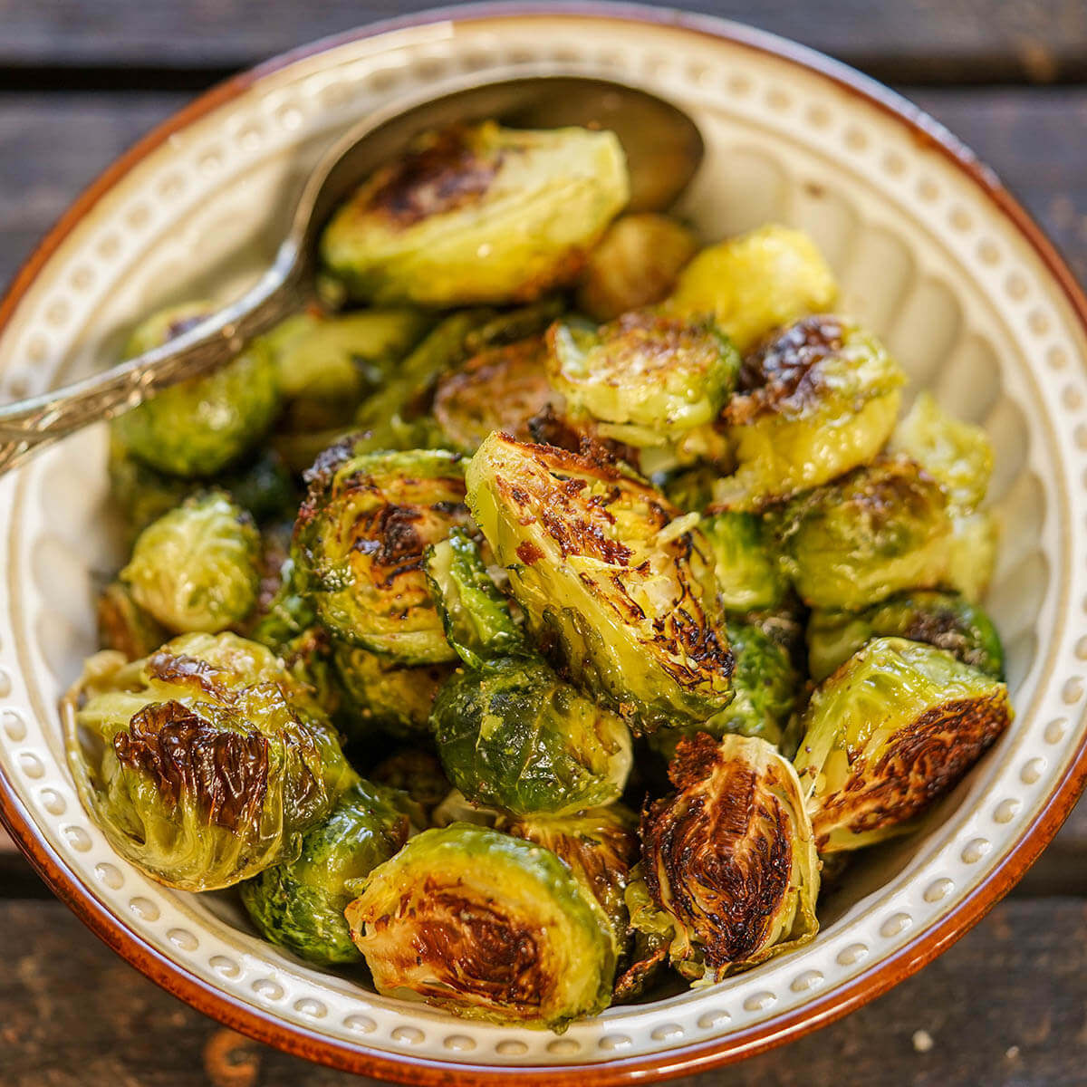 Roasted Brussel Sprouts in bowl with spoon.