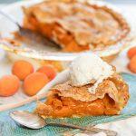 Homemade Apricot Pie Recipe on blue plate with vanilla ice cream .