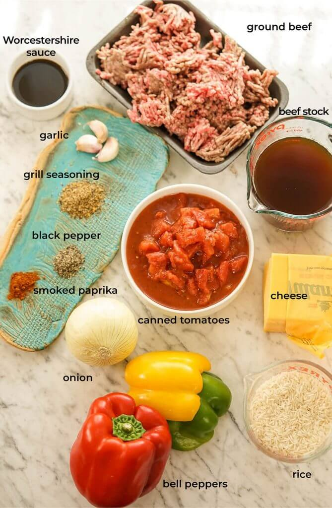 A photo with all of the ingredients laid out to make a bell pepper casserole.