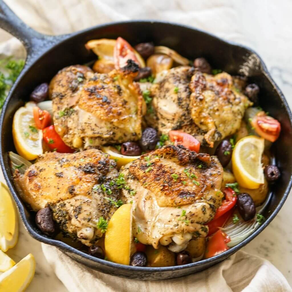 Chicken in cast iron skillet.