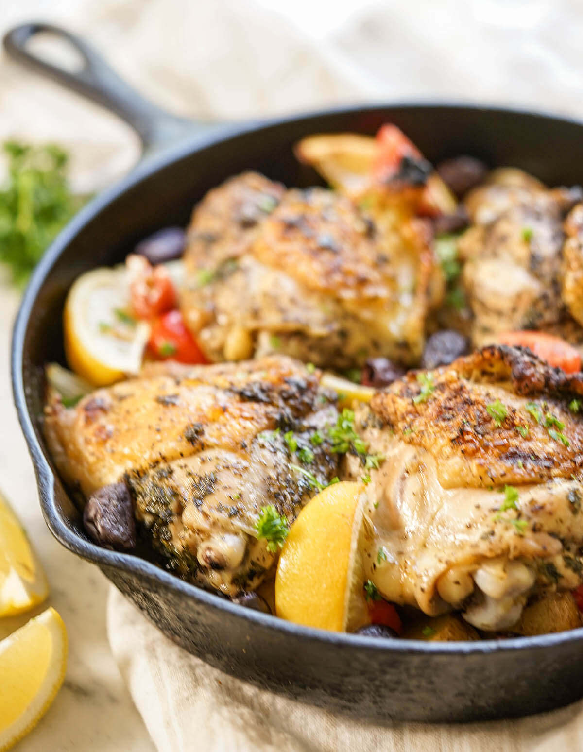 Skillet Chicken and Potatoes served with lemon.