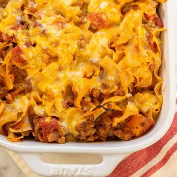 Beef and Noodle Casserole topped with melted cheese.
