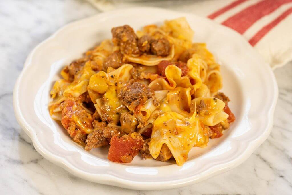 plate filled with beef and noodle casserole.