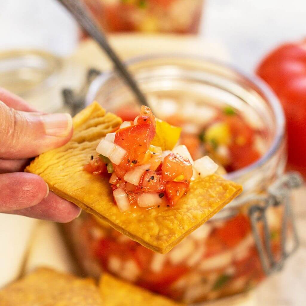 A serving of tomato relish on a cracker.
